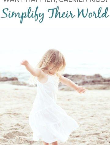 Happy preschool girl enjoying a simple day at the beach