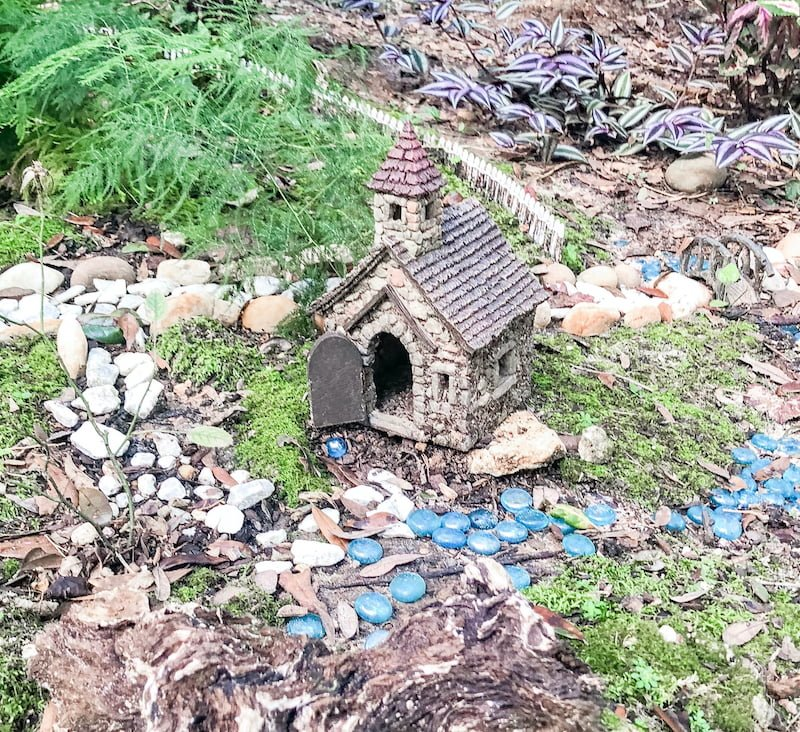 fairy house with bridge and fence - greenchildmagazine