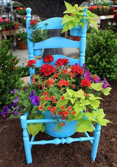 Recycled chair flower pot