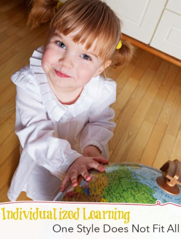 Homeschooled girl pointing to globe