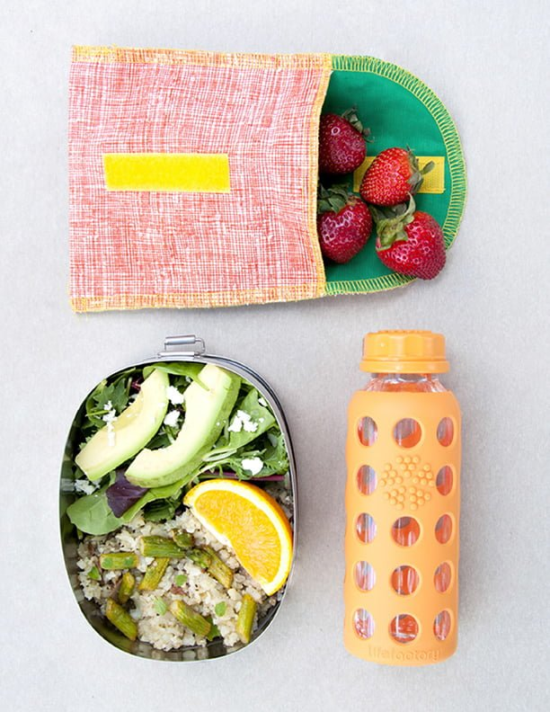 Healthy lunch ideas - Cauliflower rice with baby portabella mushrooms, garlic, and asparagus, mixed greens with feta, avocado, orange slices, and strawberries.