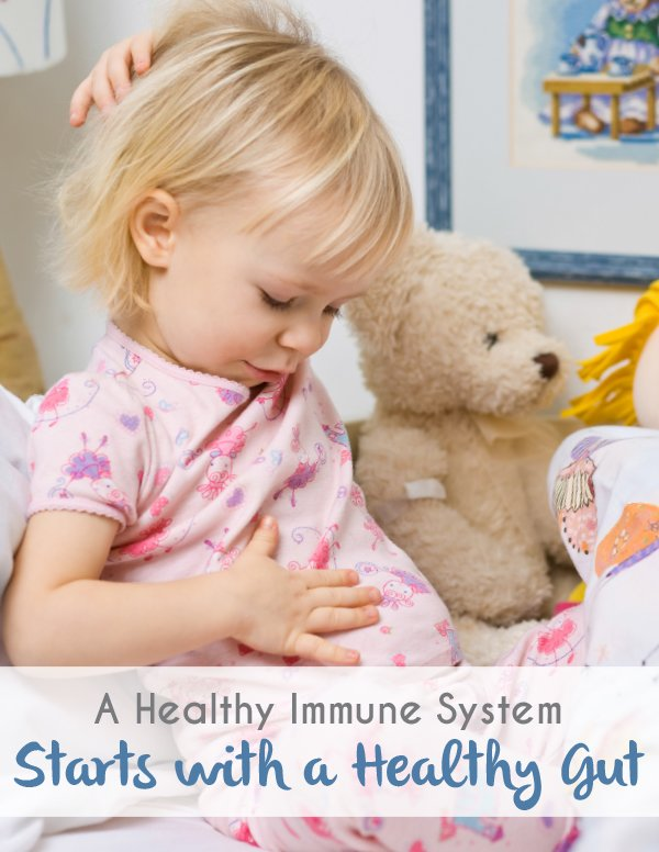 Advice on how to boost your child's gut health and image of child holding tummy
