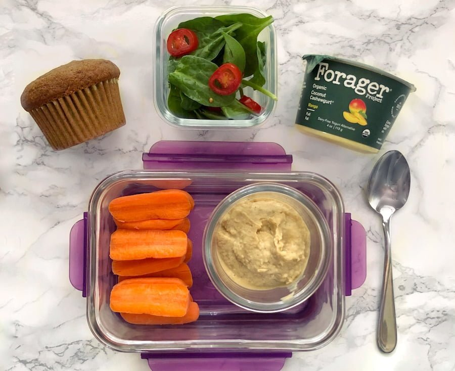Healthy lunch ideas: Simple Vegan Lunch - Organic carrots and homemade hummus, mixed greens with cherry tomatoes, Forager Organic Cashewgurt, and homemade pumpkin spice muffin.