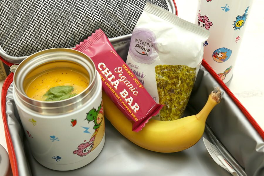 Healthy lunch ideas - Butternut squash and basil soup, organic seaweed snack, banana, and chia seed bar.