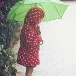 child with umbrella outside