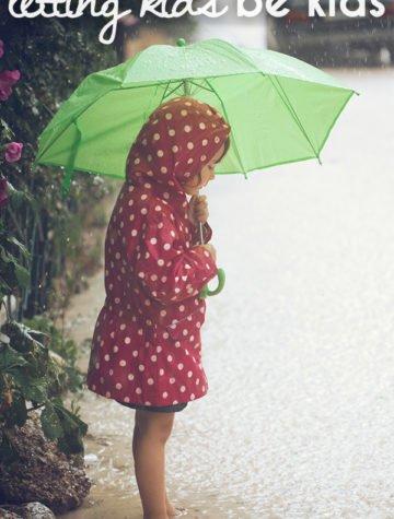 child with umbrella outside
