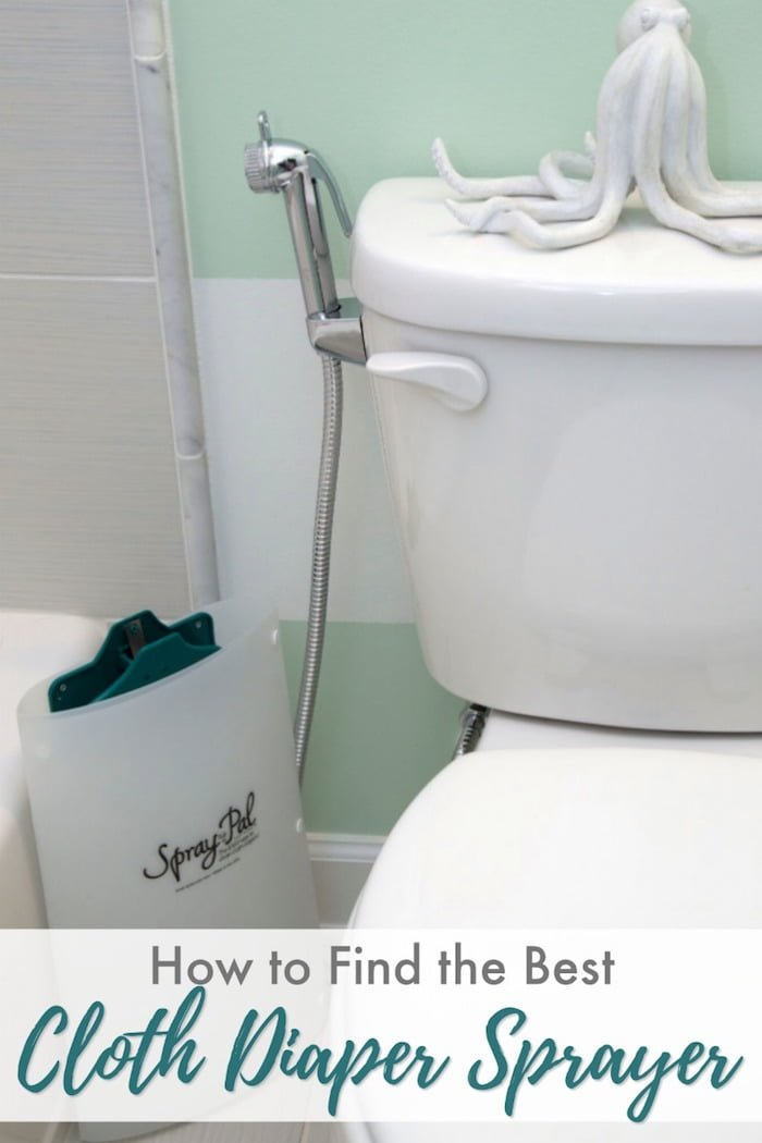 Bathroom toilet with cloth diaper sprayer attached and splatter shield