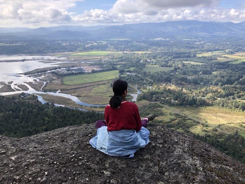 Homeschool girl on a hillside
