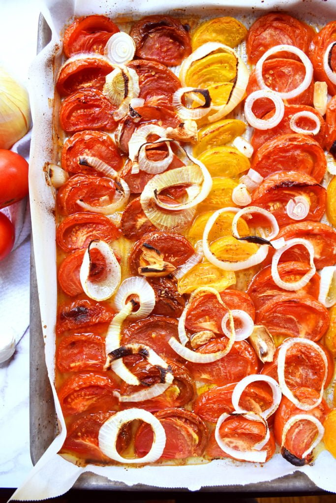 Roasted tomatoes, onions, and garlic in a large pan