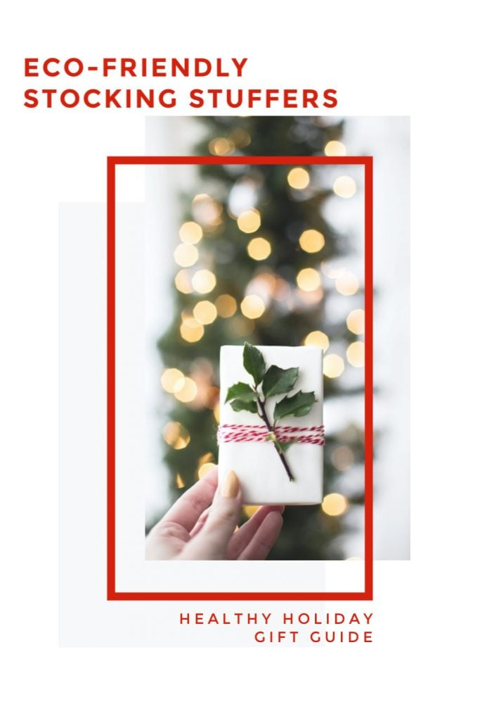 Eco-friendly stocking stuffers small holiday gift in front of Christmas tree with white lights