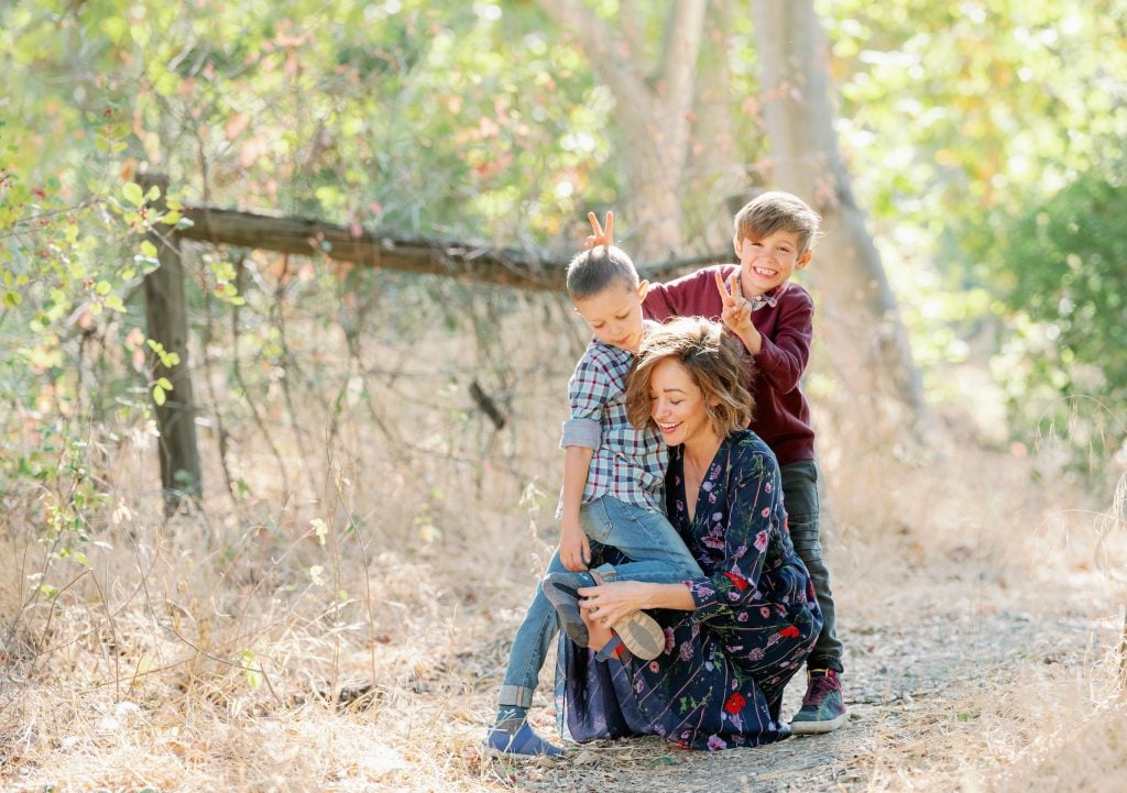 Autumn Reeser with her sons outside. Photography by Pau Von Rieter.