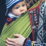 Mom babywearing in cold weather