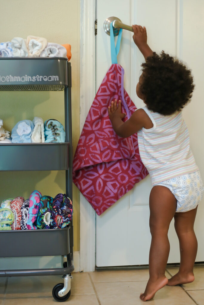 toddler in cloth diapers