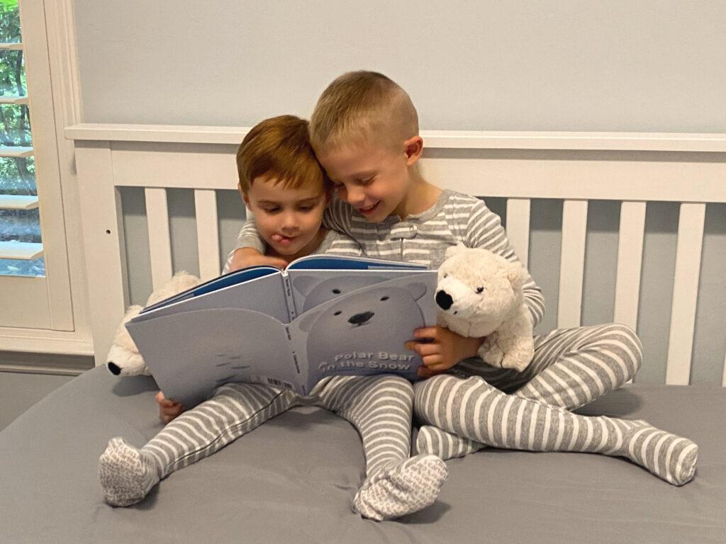 Boys reading A Polar Bear in the Snow book - Green Child Magazine