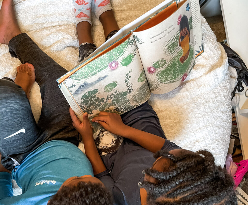 Kids reading Zonia's Rain Forest book